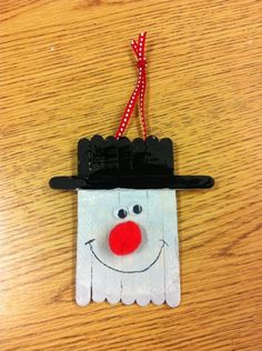 Create a snowman using craft sticks and paint and use it for your holiday or wintertime decorating! The boys made these.turned out cute! Snowman Crafts, Ornament Crafts, Snowman Ornaments, Diy Christmas Ornaments, Snowmen, Preschool Christmas, Christmas Crafts For Kids, Christmas Projects, Holiday Crafts