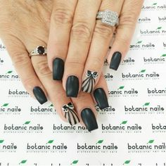 Black and nude nail art with bow