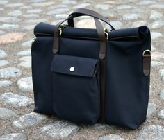 Here's an item I've been looking to get for a long time. A briefcase that would work both with a suit and less formal sport coat combinations. Now, I've been looking at all leather options, but haven't really found one I liked enough to invest in. Leather Gifts, Leather Bags Handmade, Cool Messenger Bags, Luggage Backpack, Mens Travel Bag, Denim Bag, Leather Briefcase, Cloth Bags, Fashion Bags