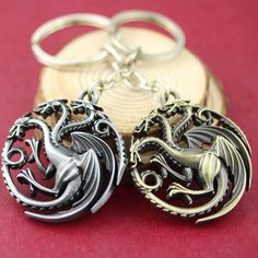 Game Of Thrones KeychainDaenerys Targaryen Blood and fire round dragon Keyring♦️ SMS - F A S H I O N  http://www.sms.hr/products/game-of-thrones-keychaindaenerys-targaryen-blood-and-fire-round-dragon-keyring/ US $1.75