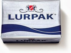Lurpak®; the logo ('Lurmark') comprises two Bronze Age lurs flanking a heraldic shield in the colours of the Danish flag. (Click through for further information)
