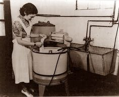 Circa 1945 - How proud she must have been of her new electric washing machine!