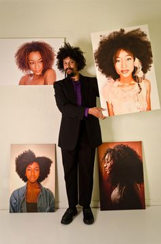 Leon Dale Photographer Holding Four of his Big Natural Hair Project 20x30 canvases!