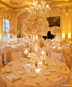 So much luxury. Perfect for the reception, but one little alteration. Giant plume feathers on top either instead or with the flowers. Lights in the tall vases also.