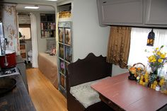 A 40 year old, restored Winnebago in Flagstaff, Arizona where the owners run abeeswax candle company.
