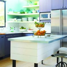 A symphony of cool pastels ? robin's egg-blue walls, smoky lilac cabinets ? infuses this kitchen with fresh colors.   Photo: Thomas J. Story   thisoldhouse.com