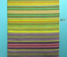 Section of Angie Parker's acid pink and green hued handwoven rug on the wall of Devon Guild for Colour Coded exhibition 2016