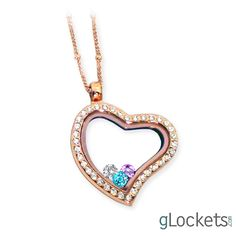 Rose gold glass heart locket necklace with family birthstones inside.