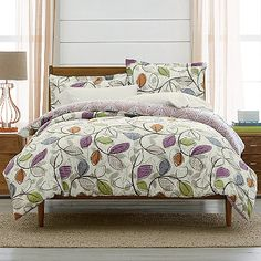 Master Bedroom Idea...LoftHome by The Company Store® Lyric Leaf Bedding. Gray walls, cream window treatments, purple sheets, gray throw, green and orange throw pillows.