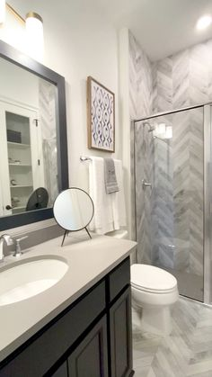 Herringbone Shower Tile Design Beautiful bath with dark cabinetry and herringbone tile pattern in th Bathroom Interior Design, Tile Design, Bathroom Makeover, Diy Bathroom Remodel, Bathroom Renovations, Herringbone Tile, Bathroom Renovation Diy, Shower Tile Designs, Small Bathroom Makeover