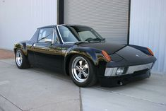 Porsche 914. I know it's not a 'real Porsche', it's the 'poor man's Porsche', but it's an amazing, lightweight, mid-engine car regardless of its humble VW beginnings. And it goes like hell with a V8 retrofitted into the back, too.