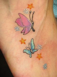 Blue and pink small butterfly tattoo with stars - tattooimages. Tiny Butterfly Tattoo, Butterfly Tattoo On Shoulder, Pink Butterfly, Butterflies, Unique Small Tattoo, Ankle Tattoo Small, Small Tattoo Designs, Ankle Tattoos For Women, Tattoos For Women Small