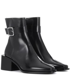 Jil Sander - Leather ankle boots - It's the chunky square-shaped heel that really defines Jil Sander's city-chic ankle boots. Crafted in Italy from smooth black leather, this pair come with a high, slim neck and a buckle-embellished strap detail. The square toe adds a masculine flourish – team yours with leggings and a sweater dress this season. seen @ www.mytheresa.com