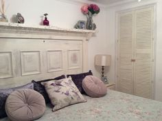 Shabby chic bedroom with old door used as head board Louvre doors old pine furniture painted with shabby paint