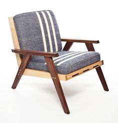 The Station Chair. Part of the North Collection by Nova Scotia's Trunk Studio. Available in either walnut, birch or a mixture. Cushion fabrics include this PEI MacAuslan Woolen Mill design.