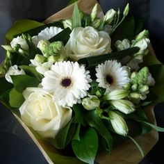 Fresh, clean looking bouquet with a wide range of white flowers and green foliages.  Part of our Mothers Day 2016 Collection.