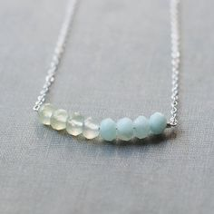 calliope  silver and light green necklace by by elephantine, $37.00