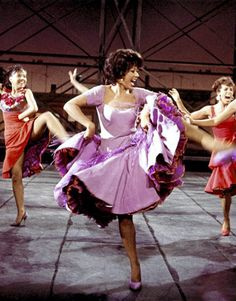 This is a picture of Rita Moreno who played Anita in the Broadway and movie versions of West Side Story.  Anita, a feisty, mature, and sexy Latina woman, is a dancer in the show.  I am a dancer too, and while I've already played this part twice in my life, I still look to Rita Moreno for guidance and inspiration.  I love the role of Anita, and hope to play her professionally one day.