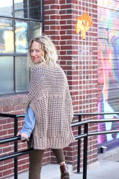 "You'd never guess by looking at this sweater that it's made from two simple rectangles! The Cocoon Cardigan free crochet pattern is great for beginners who are looking to expand their skills or advanced crocheters who want a quick, stylish project. Made with Lion Brand Lion's Pride Woolspun yarn in ""Taupe."""