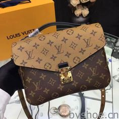 Louis Vuitton Pochette Métis Bag Monogram Reverse - The trendy Pochette Métis is given a highly fashionable twist with this iconic Monogram Infrarouge canvas, inspired by Nicolas Ghesquière's work. Sacs Louis Vuiton, Pochette Louis Vuitton, Louis Vuitton Crossbody, Louis Vuitton Monogram, Crossbody Bag, Black Handbags, Louis Vuitton Handbags, Purses And Handbags, Classic Handbags