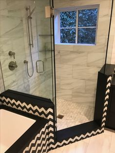 Porcelain tile sower and black and white chevron cement decos