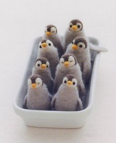 Oh my! How cute are these needle felted penguins.