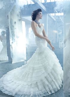 Luxury Lazzaro wedding gown with intricate pleating and ruffles for a fairytale wedding. Enjoy RUSHWORLD boards, WEDDING GOWN HOUND, UNPREDICTABLE WOMEN HAUTE COUTURE and MY GOD IT'S FULL OF STARS. Follow RUSHWORLD! We're on the hunt for everything you'll love!