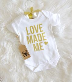 Hey, I found this really awesome Etsy listing at https://www.etsy.com/listing/266057397/love-made-me-onesie-baby-onesie-gold