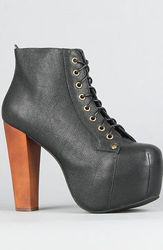 Alright ladies and gentlemen, this is the epitome of shoe wear, the Jeffrey Campbell Lita Shoe in black. Sure it maybe resembles something a nazi, Wiccan, runway model would wear to her wedding, but come on you can't tell me they aren't the most beautiful overpriced blocks of leather and wood that you've ever seen in your whole life right?