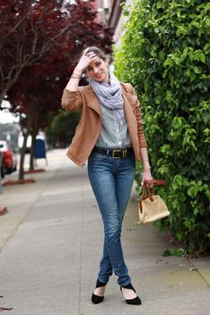 Denim, a blazer, and heels: Easy, breezy, casual wear for the office.  Feel free to add a fun scarf or funky jewelry.
