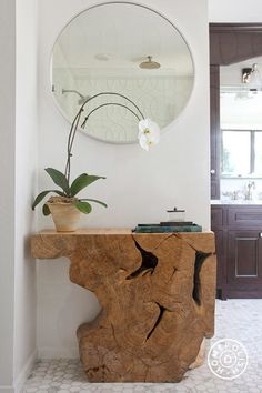Organically shaped wood console table #interiordesign