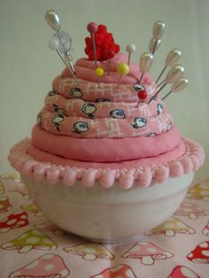 tutorial here: http://shelleyrodgers.blogspot.com/2009/07/i-made-this-polka-dot-teacup-pincushion.html