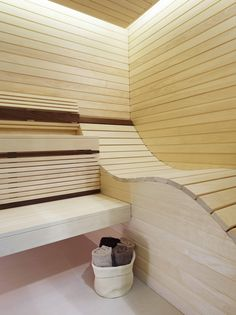 A sleek ergonomically curved lounger makes bathing more comfortable in this elegant sauna room from Dröm UK.
