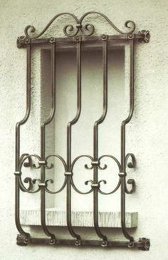 colonial wrought iron security bars windows - Google Search