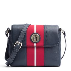 The Waverly Crossover is a beautiful new addition to the Tommy Hilfiger bag collection. Made from a beautiful pebbled leather with a grosgrain center stripe, it also features an adjustable strap. Front flap snaps shut.