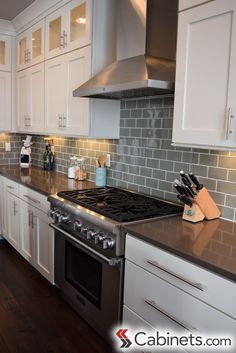 A beautiful transitional style kitchen with Shaker Maple Antique White cabinets, stainless steel bar pulls, and subway tile backsplash.