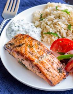 This delicious and easy Greek Salmon is the perfect quick healthy dinner for the whole family. The marinade is a simple mix of olive oil, lemon, dill, and oregano. The fish is pan-fried, giving it a wonderfully crisp exterior and meltingly tender and succulent center. Perfect for serving with orzo and a Greek salad. Transport your self to Greece with the traditional and authentic recipe for Greek Salmon! Greek Salmon Recipe, Crispy Salmon Recipe, Best Grilled Salmon Recipe, Cooking Salmon Fillet, Delicious Salmon Recipes, Healthy Recipes, Healthy Eats, Fried Salmon
