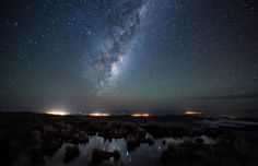 The Milky Way above the Wairarapa in New Zealand. From left to right you can see the towns of Masterton, Carterton, Greytown, Martinborough and a faint glow from Featherston. From the top of the Tararua Ranges which is around above sea level. By Mark Gee