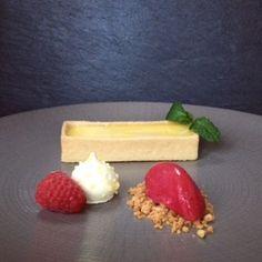 Lemon tart, mini meringue, raspberry caramel crumbs #pudding #summer   http://www.gooseandberry.co.uk/