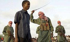 """""""Al-Shabaab, which members are recognizable because almost all of their insurgents wear bright red keffiyehs and dark green uniforms, has been waging an insurgency since 2007 against the Somali government in a bid to impose its own strict version of Sharia law."""""""