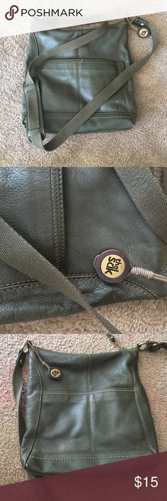 The Sak leather Purse Front and back pockets with zipper pocket inside and 2 small pockets a phone and small wallet. Has zipper that close purse! Great condition! The Sak Bags Crossbody Bags