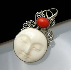 Love the little carved moon face jewelry