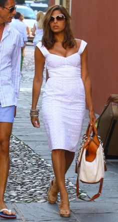 Eva Mendes wearing Christian Louboutin Delfin Espadrille Sandals, Oliver Peoples Annice Sunglasses and Dolce & Gabbana Eyelet Dress.