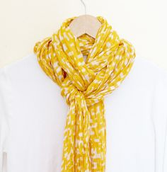 This may be the easiest and one of the classiest ways to tie a scarf!