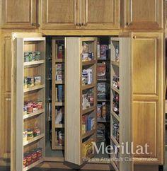Tall Multi-Storage Pantry - Masterpiece® Accessories - Merillat® cabinetry. Tall pantry cabinet includes door storage racks and internal swing racks for optimal storage. Can be used for a variety of items including dry goods, canned and bottled goods and seasonings.