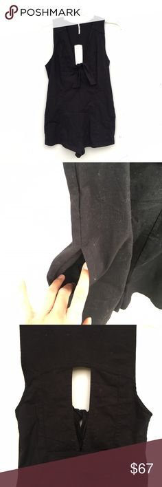"""Free People NWOT Daisy Black Romper Brand new without tags and unworn Free People """"Daisy"""" romper in black. Has a v-neck with a small tie in the front, and a cut out in the back. Overexposed second image to show pockets on each sides. 98% cotton, 2% spandex. Free People Pants Jumpsuits & Rompers"""