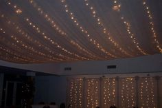 Wedding reception lighting.  Tulle and white christmas lights. emily-wedding-ideas