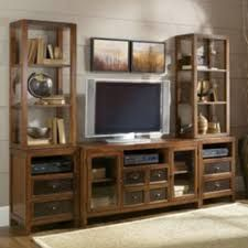 CLIENTS LIKE THIS ENTERTAINMENT CENTER BUT THEY MIGHT GO WITH A COLLECTION FROM EVANS FURNITURE STORE