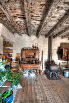 Farmhouse Inspiration - wood floors, wood beam ceiling, notice how the canning jars on the left decorate the room