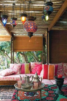 Colorful paper lanterns lend a summer bohemian feel to outdoor space.   - HarpersBAZAAR.com